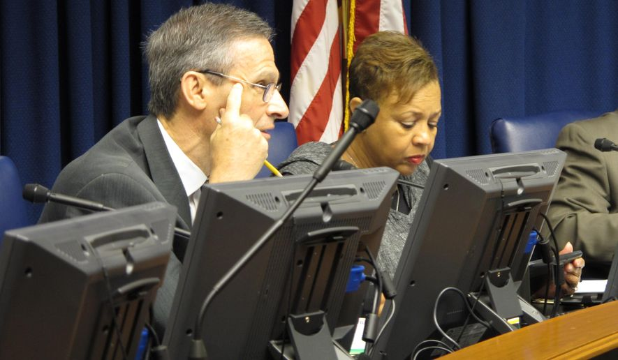 Sen. Fred Mills, R-Breaux Bridge, and Sen. Yvonne Dorsey-Colomb, D-New Orleans, listen during testimony to a Senate judiciary committee about a bill to lessen marijuana penalties on Tuesday, April 22, 2014, in Baton Rouge, La. (AP Photo/Melinda Deslatte)