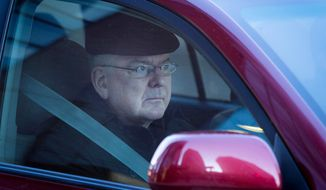 In this photo taken on Wednesday, April 2, 2014, Archbishop John Nienstedt, leader of the Archdiocese of St. Paul and Minneapolis, rides in a vehicle in St. Paul, Minn., on his way to giving a deposition. Attorneys for victims of alleged sexual abuse by priests are releasing the deposition of Nienstedt. It was the first time since he became archbishop six years ago that he has had to answer these questions under oath. The deposition was taken as part of a lawsuit filed by a man who claims a priest abused him in the 1970s. (AP Photo/Minnesota Public Radio,  Jennifer Simonson) MANDATORY CREDIT