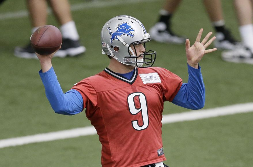 Detroit Lions quarterback Matthew Stafford runs through drills at the Lions training facility in Allen Park, Mich., Tuesday, April 22, 2014. (AP Photo/Carlos Osorio)
