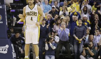 Indiana Pacers' Luis Scola (4) celebrates during the second half in Game 2 of an opening-round NBA basketball playoff series against the Atlanta Hawks Tuesday, April 22, 2014, in Indianapolis. Indiana defeated Atlanta 101-85. (AP Photo/Darron Cummings)