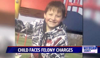 Edward Hart, 8, face two felony charges in Michigan after he got into an altercation with police and destroyed a camera last month. (FOX 17)