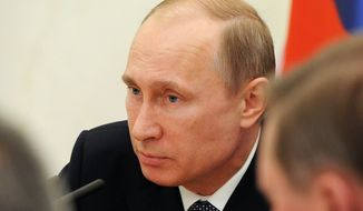 Russian President Vladimir Putin chairs a Security Council meeting in the Kremlin in Moscow, Russia, Tuesday, April 22, 2014. (AP Photo/RIA-Novosti, Mikhail Klimentyev, Presidential Press Service)