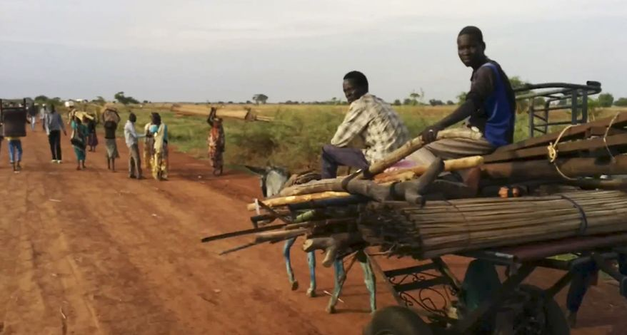"""This image was taken from video of people traveling on the road near Bentiu South Sudan on Sunday April 20, 2014. U.N.'s top humanitarian official in South Sudan Toby Lanzer  told The Associated Press in a phone interview Tuesday, April 23, 2014, that the ethnically targeted killings are """"quite possibly a game-changer"""" for a conflict that has been raging since mid-December and that has exposed longstanding ethnic hostilities. (AP Photo/Toby Lanzer, United Nations)"""