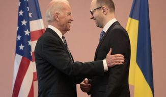"""U.S. Vice President Joe Biden, left, talks with Ukrainian Prime Minister Arseniy Yatsenyuk during a meeting in Kiev, Ukraine, Tuesday, April. 22, 2014. Vice President Joe Biden told Ukrainian political leaders Tuesday that the United States stands with them against """"humiliating threats"""" and encouraged them to root out corruption as they rebuild their government. In the most high-level visit of a U.S. official since crisis erupted in Ukraine, Biden told leaders from various political parties that he brings a message of support from President Barack Obama as they face a historic opportunity to usher in reforms. (AP Photo/Sergei Chuzavkov)"""