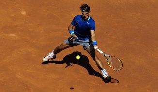 Spain's Rafael Nadal returns the ball to fellow countryman Albert Ramos during the Barcelona open tennis in Barcelona, Spain, Wednesday, April 23, 2014. (AP Photo/Manu Fernandez)