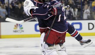 Columbus Blue Jackets' Nick Foligno, left, and Sergei Bobrovsky, of Russia, celebrate Foligno's game-winning goal against the Pittsburgh Penguins in Game 4 of a first-round NHL playoff hockey series on Wednesday, April 23, 2014, in Columbus, Ohio. The Blue Jackets defeated the Penguins 4-3 in overtime. (AP Photo/Jay LaPrete)
