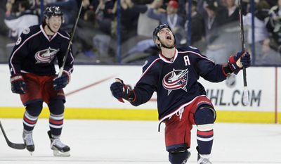 Columbus Blue Jackets' Brandon Dubinsky, right, celebrates his game-tying goal against the Pittsburgh Penguins during the third period of Game 4 of a first-round NHL playoff hockey series on Wednesday, April 23, 2014, in Columbus, Ohio. (AP Photo/Jay LaPrete)