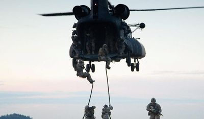 ** FILE ** Army Rangers practice fast rope insertion and extraction. The Special Operations Command budget for the next year is $7.7 billion, representing a 10 percent increase. The command is taking steps to head off a severe readiness dip in its far-flung troops. (U.S. Army)