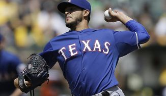 Texas Rangers' Martin Perez works against the Oakland Athletics in the first inning of a baseball game Wednesday, April 23, 2014, in Oakland, Calif. (AP Photo/Ben Margot)