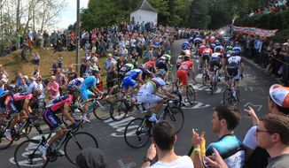 Cyclists climb the 'wall of Huy' during the Belgian cycling classic and UCI World Tour race Walloon Arrow/Fleche Wallonne, in Huy, Belgium, Wednesday, April 23, 2014. (AP Photo/Yves Logghe)