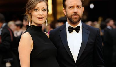 "FILE - In this Sunday, March 2, 2014 file photo, Olivia Wilde, and Jason Sudeikis arrive at the Oscars at the Dolby Theatre in Los Angeles. It's a boy for Wilde and Sudekis. A spokeswoman for the ""Tron: Legacy"" actress said the couple welcomed son Otis Alexander on Sunday, April 20, 2014.  (Photo by Chris Pizzello/Invision/AP, file)"