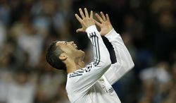 Real's Cristiano Ronaldo reacts after failing to score during a Champions League semifinal first leg soccer match between Real Madrid and Bayern Munich at the Santiago Bernabeu stadium in Madrid, Spain, Wednesday, April 23, 2014. (AP Photo/Paul White)