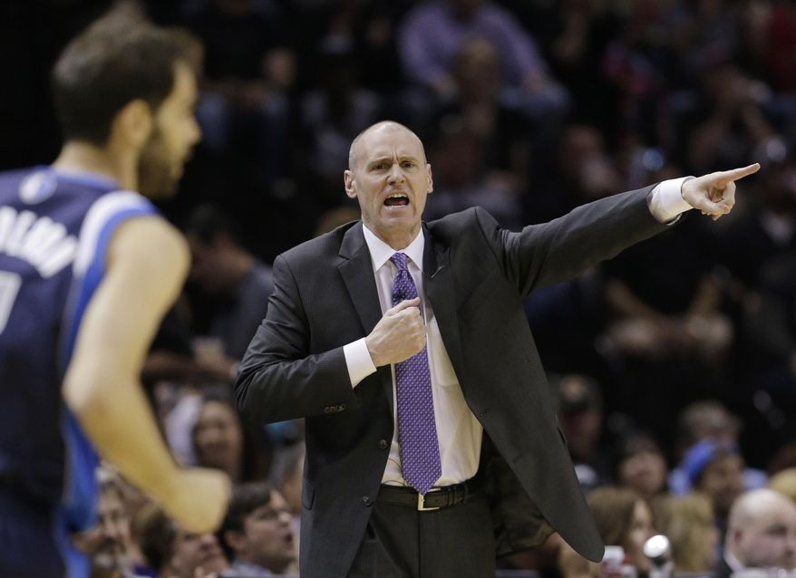 Dallas Mavericks coach Rick Carlisle signals to his players during the first half of Game 2 of the opening-round NBA basketball playoff series against the San Antonio Spurs, Wednesday, April 23, 2014, in San Antonio. (AP Photo/Eric Gay)
