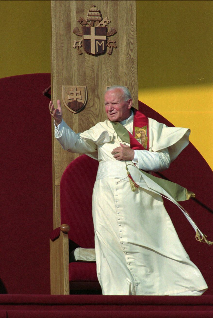 """His time has come: John Paul II """"was a truly authentic guy,"""" said a Maryland man who served at the pope's side from 1986 to 1988. John Paul and Pope John XXIII will be canonized as saints during a Vatican ceremony Sunday. (Associated Press)"""