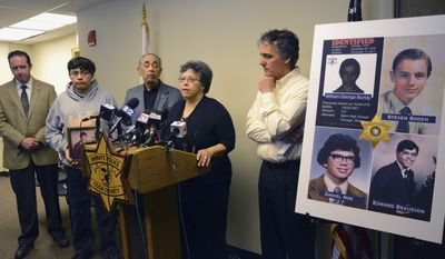 Ruth Rodriguez speaks at a news conference Wednesday, April 23, 2014, in Maywood, Ill., after Cook County Sheriff Tom Dart, right, announced that the remains of a man found in 2008, belonged to Rodriguez's brother, Edward Beaudion, who went missing in 1978. Investigators identified the remains just a few miles from serial killer John Wayne Gacy's house. They also say they know the identity of his now-deceased killer. The discovery was the result of an ongoing effort to name several unidentified victims of Gacy, who was executed in 1994. Looking on are Cook County Sheriff's Detective Jason Moran, left, Edward's father, Louis Beaudion and Ruth's son, Jesus Rodriguez, second from left, holding a photo of Edward. (AP Photo/Sun-Times Media, Brian Jackson)  MANDATORY CREDIT, MAGS OUT, NO SALES