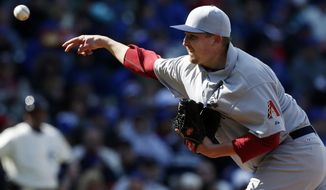 Arizona Diamondbacks pitcher Trevor Cahill pitches against the Chicago Cubs during the seventh inning of a baseball game at Wrigley Field in Chicago on Wednesday, April 23, 2014. (AP Photo/Andrew A. Nelles)