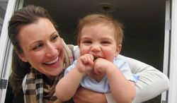 This 2010 photo provided by Stacey Armato of Hermosa Beach, Calif. shows her with her son, Lorenzo. Armato, who was held at a Phoenix airport in 2010 after refusing to have her breast milk X-rayed, said Wednesday, April 23, 2014 that TSA officials have tentatively offered her $75,000, along with promises to retrain agents and clarify its guidelines on sceening breast milk. (AP Photo/Stacey Amato)