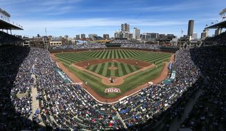 The Arizona Diamondbacks and Chicago Cubs begin a baseball game Wednesday, April 23, 2014, in Chicago. Wednesday was the 100th anniversary of the first game at the ballpark, between the Chicago Federals and the Kansas City Packers. (AP Photo/Charles Rex Arbogast)