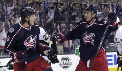 Columbus Blue Jackets' Ryan Johansen, left, celebrates his goal against the Pittsburgh Penguins with teammate Artem Anisimov, of Russia, during the second period of Game 4 of a first-round NHL hockey playoff series on Wednesday, April 23, 2014, in Columbus, Ohio. (AP Photo/Jay LaPrete)
