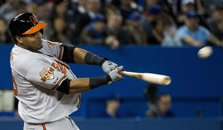 Baltimore Orioles' Nelson Cruz hits a grand slam against the Toronto Blue Jays during fifth-inning baseball game action in Toronto, Wednesday, April 23, 2014. (AP Photo/The Canadian Press, Nathan Denette)