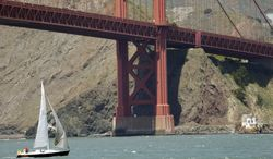 A sail boat makes its way under the Golden Gate Bridge on Wednesday, April 23, 2014, in San Francisco.  A National Oceanic and Atmospheric Administration team has found the shipwreck of the City of Chester vessel in the area. The ship sunk in the San Francisco Bay in 1888 after a collision with a larger ship. The first images of the newly discovered wreckage were were released Wednesday by federal ocean scientists. (AP Photo/Marcio Jose Sanchez)