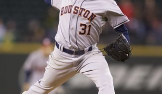 Houston Astros starter Collin McHugh delivers a pitch in the seventh inning of a  baseball game against the Seattle Mariners, Tuesday, April 22, 2014, in Seattle. (AP Photo/Stephen Brashear)
