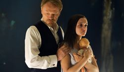 "This image released by Lionsgate shows Jared Harris, left, and Olivia Cooke in a scene from ""The Quiet Ones."" (AP Photo/Lionsgate, Chris Harris)"