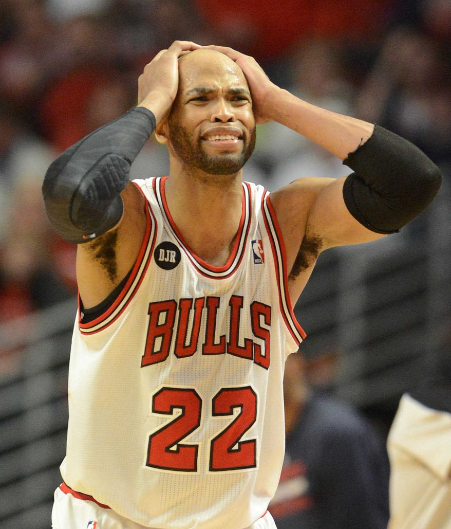 Chicago Bulls forward Taj Gibson (22) reacts as things start going the Wizards' way  during Game 2 in an opening-round NBA basketball playoff series Tuesday, April 22, 2014, in Chicago. The Wizards won 101-99. (AP Photo/Daily Herald, Rick West)