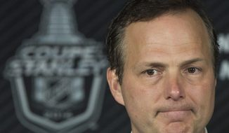 Tampa Bay Lightning's head coach Jon Cooper speaks to reporters after losing to the Montreal Canadiens of NHL Stanley Cup playoff action in Montreal, Tuesday, April 22, 2014. The Canadiens win the best of seven series 4-0. (AP Photo/The Canadian Press, Graham Hughes)