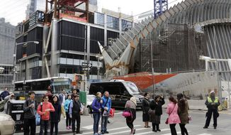 Pedestrians walk past 3 World Trade Center, left, and the Transportation Hub, right, both under construction, Wednesday, April 23, 2014 in New York. At its monthly meeting Wednesday, the Port Authority of New York and New Jersey postponed a decision on whether to approve more than $1 billion in financing for Silverstein Properties' retail and office tower, 3 World Trade Center. The tower, planned for 73 floors, is now up to seven floors. (AP Photo/Mark Lennihan)