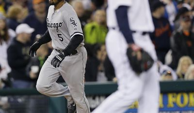 Chicago White Sox's Marcus Semien rounds the bases after his grand slam as Detroit Tigers relief pitcher Ian Krol walks back to the mound during the seventh inning of a baseball game in Detroit, Wednesday, April 23, 2014. (AP Photo/Carlos Osorio)