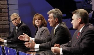 North Carolina Republican senatorial candidate Greg Brannon, second from right, responds during a live televised debate at WRAL television studios as Thom Tillis, left, Heather Grant, and Mark Harris, right, listen in Raleigh, N.C., Wednesday, April 23, 2014. (AP Photo/Gerry Broome, Pool)