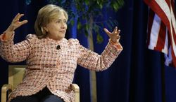 Former Secretary of State Hillary Rodham Clinton gestures during the question and answer session of her Simmons College Leadership Conference keynote address at the Seaport World Trade Center Wednesday, April 23, 2014 in Boston. (AP Photo/Stephan Savoia)