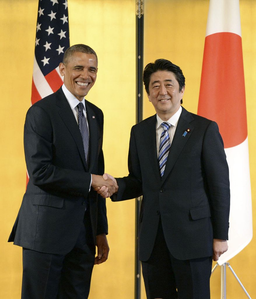 Japanese Prime Minister Shinzo Abe, right, shakes hands with U.S. President Barack Obama prior to their talks at the Akasaka State Guest House in Tokyo, Thursday, April 24, 2014.  Facing fresh questions about his commitment to Asia, Obama will seek to convince Japan's leaders Thursday that he can deliver on his security and economic pledges, even as the crisis in Ukraine demands U.S. attention and resources elsewhere. (AP Photo/Toru Yamanaka, Pool)