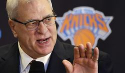 FILE - In this March 18, 2014 file photo, Phil Jackson, the new president of the New York Knicks, answers questions during a news conference in New York. Jackson won't be hiring himself to coach the Knicks. Two days after firing Mike Woodson, Jackson reiterated Wednesday, April 23, 2014,  that he won't be returning to the bench, despite the fact that even fiancee Jeanie Buss told him he should. (AP Photo/Mark Lennihan, File)