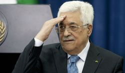 Palestinian President Mahmoud Abbas gestures during a meeting with Jordanian Prime Minister Abdullah Ensour, in the West Bank city of Ramallah, Wednesday, April 23, 2014. (AP Photo/Majdi Mohammed)