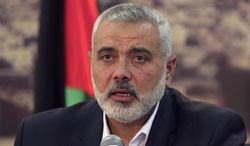 Gaza's Hamas Prime Minister Ismail Haniyeh, during a press conference following the announcement of an agreement between the two rival Palestinian groups, Hamas and Fatah, at Haniyeh's residence in Shati Refugee Camp, Gaza Strip, Wednesday, April 23, 2014. Hamas and Fatah made a new attempt Wednesday to overcome the Palestinians' political split, saying they would seek to form an interim unity government within five weeks, followed by general elections by December at the earliest.  It was not clear how the new attempt announced Wednesday would succeed where previous ones failed, since the fundamental difficulties remain in place. (AP Photo/Adel Hana)