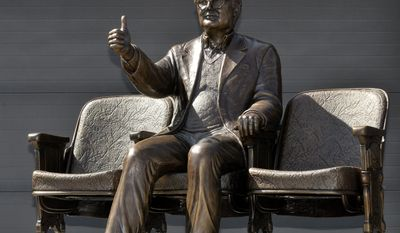 """This April 22, 2013 photo provided by Thompson-McClellan shows a bronze statue of Pulitzer Prize winning film critic Roger Ebert giving his famous 'thumbs up"""" sign in Champaign, Ill. The statue will be unveiled Thursday, April 24, 2014, outside the Virginia Theatre in Champaign where Ebert held his annual film festival. Ebert died in April 2013.  (AP Photo/Courtesy of Thomspon.McClellan)"""