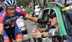"""FILE - In this July 29, 2007 file photo, Lance Armstrong, seated into a car of the Discovery Channel cycling team, right, jokes with teammate George Hincapie  during the 20th and last stage of the 94th Tour de France cycling race between Marcoussis, southwest of Paris, and Paris. Hincapie was the """"Loyal Lieutenant"""" who helped Lance Armstrong to seven Tour de France titles, only to later provide the key testimony that brought his downfall. Now, Hincapie is peeling back the shroud that has long covered the dark era of doping in cycling in a book due out next month that is part memoir, part mea culpa. (AP Photo/Christophe Ena, File)"""