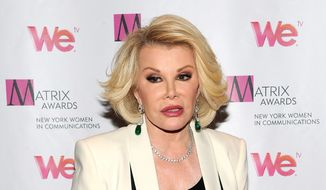 ** FILE ** In this April 22, 2013, file photo, television personality Joan Rivers attends the 2013 Matrix New York Women in Communications Awards at the Waldorf-Astoria Hotel, in New York. (Photo by Evan Agostini/Invision/AP, File)