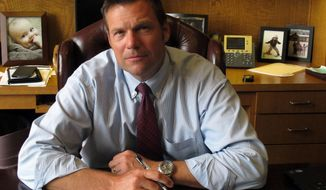 In this photo from Thursday, Aug. 1, 2013, Kansas Secretary of State Kris Kobach answers questions during an Associated Press interview in Topeka, Kan. Kobach is the architect of a state law requiring voters to show photo identification at the polls. (AP Photo/John Hanna)