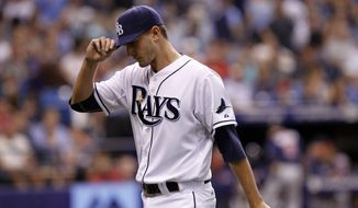 Tampa Bay Rays starting pitcher Jake Odorizzi walks to the dugout after being taken off the mound by manager Joe Maddon during the fourth inning of a baseball game against the Minnesota Twins, Wednesday, April 23, 2014, in St. Petersburg, Fla. (AP Photo/Brian Blanco)