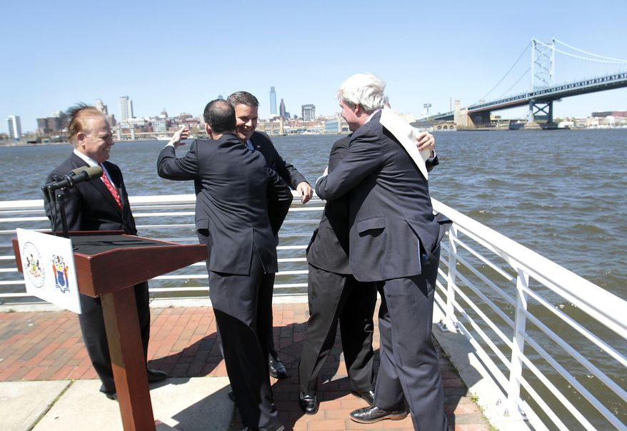From Left, New Jersey Sen. Joe Pennacchio, Pennsylvania Rep. Mike Vereb, Pennsylvania Auditor General Eugene DePasquale, Pennsylvania Sen. John Rafferty and DRPA member John Dougherty congratulate each other after holding a press conference near the Ben Franklin Bridge in Camden, N.J., to announce bi-state legislation to reform the Delaware River Port Authority, Thursday, April 24, 2014. (AP Photo/Gloucester County Times, Tim Hawk)  PHILLY METRO OUT NEWS