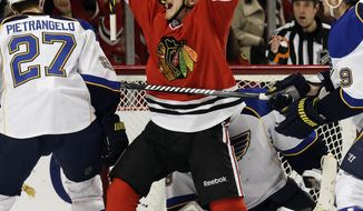 Chicago Blackhawks' Andrew Shaw (65) celebrates after scoring a goal during the second period in Game 4 of a first-round NHL hockey playoff series against the St. Louis Blues in Chicago, Wednesday, April 23, 2014. (AP Photo/Nam Y. Huh)