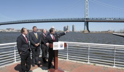 Pennsylvania Auditor General Eugene DePasquale points to the Ben Franklin Bridge during a press conference to announce bi-state legislation to reform the Delaware River Port Authority, Thursday, April 24, 2014 in Camden, N.J.. With him are, from left, New Jersey Sen. Joe Pennacchio, Pennsylvania Rep. Mike Vereb, Pennsylvania Sen. John Rafferty and DRPA member John Dougherty. (AP Photo/Gloucester County Times, Tim Hawk)  PHILLY METRO OUT NEWS, MAGS OUT. NO SALES