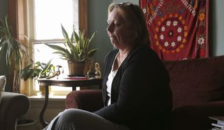 Jan Schuitema, wife of Dr. Jerry Umanos, discusses her husband's work in Afghanistan on Thursday in Chicago. Dr. Umanos, a pediatrician, was killed when an Afghan security guard opened fire Thursday at a Kabul hospital. (associated press)