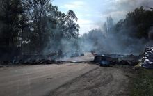 Smoke billows from burning tires at a checkpoint after an attack by Ukrainian troops outside Slovyansk, Ukraine, on Thursday. Ukrainian troops moved against pro-Russia forces in the east of the country and killed at least five of them.