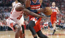 Pivot: After driving on Chicago Bulls guard Tony Snell during Game 2 in an opening-round NBA basketball playoff series Tuesday, Washington Wizards guard John Wall finds Game 3 the most important one of the season. (Associated press)