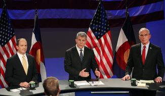 Colorado Secretary of State Scott Gessler, center, gestures while answering a question, flanked by former state Sen. Mike Kopp, left, and former Rep. Bob Beauprez during a debate of the Colorado Republican gubernatorial hopefuls hosted by 9NEWS, in Denver, Thursday April 24, 2014. A fourth candidate, former U.S. Rep. Tom Tancredo, chose not to participate in the debate. The GOP primary is in June. (AP Photo/Brennan Linsley)
