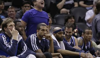 Dallas Mavericks owner Mark Cuban, top, cheers from behind the team's bench during the second half of Game 2 of the opening-round NBA basketball playoff series against the San Antonio Spurs, Wednesday, April 23, 2014, in San Antonio. Dallas won 113-92. (AP Photo/Eric Gay)
